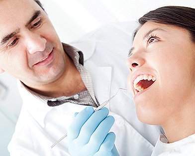 Dentists and Patient working on oral care